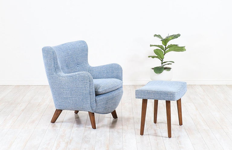 Elegant Modern lounge chair Model-4688 designed by George Nelson for Herman Miller in the United States in 1946. This iconic lounge chair with its ottoman set is crafted with solid walnut wood feet features an ergonomic seat with light-blue tweed