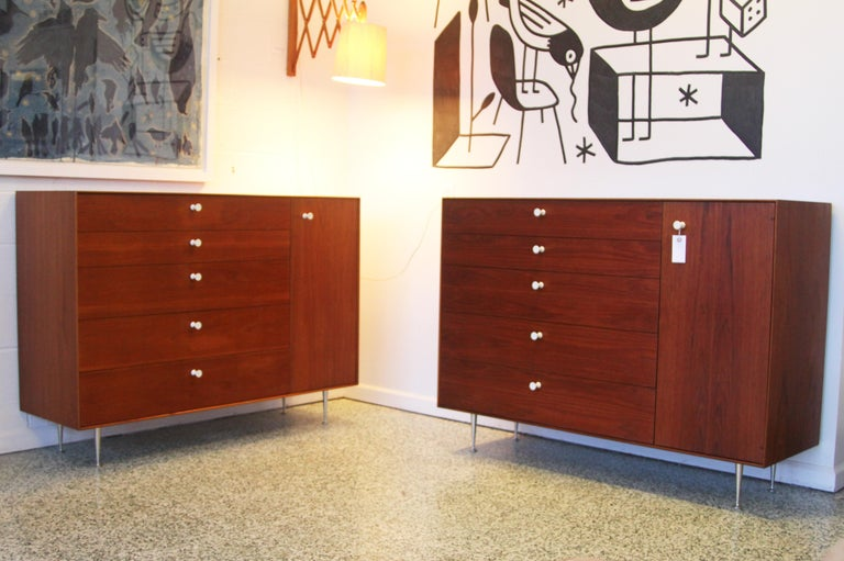 Designer: George Nelson  Manufacture: Herman Miller  Period/style: Mid-Century Modern  Country: USA Date: 1950s  We were told from the original owner these chests are prototypes due to the second drawer being smaller than the first. The