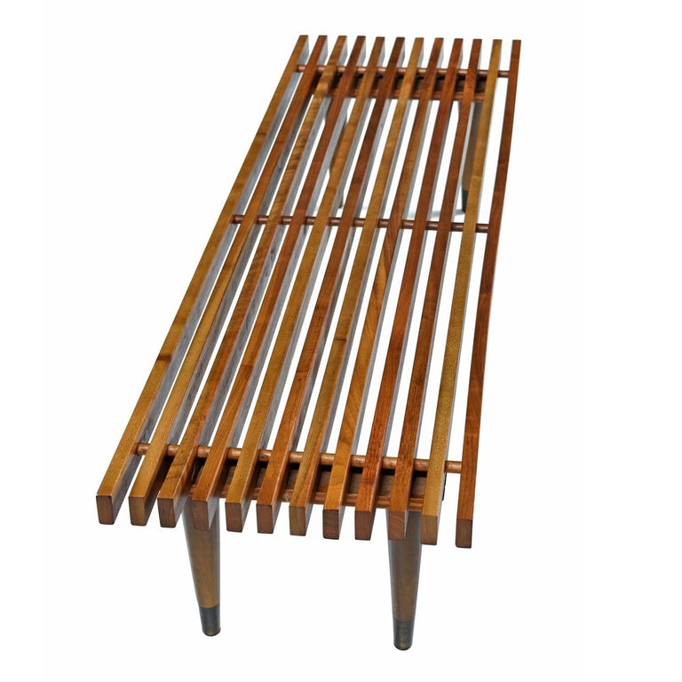 Without any markings or typical signs of production furniture of the 1950s, we think this may be a home made creation. The mid-century modern slat bench is perhaps one of the most recognizable and beloved pieces of furniture from the period. Every