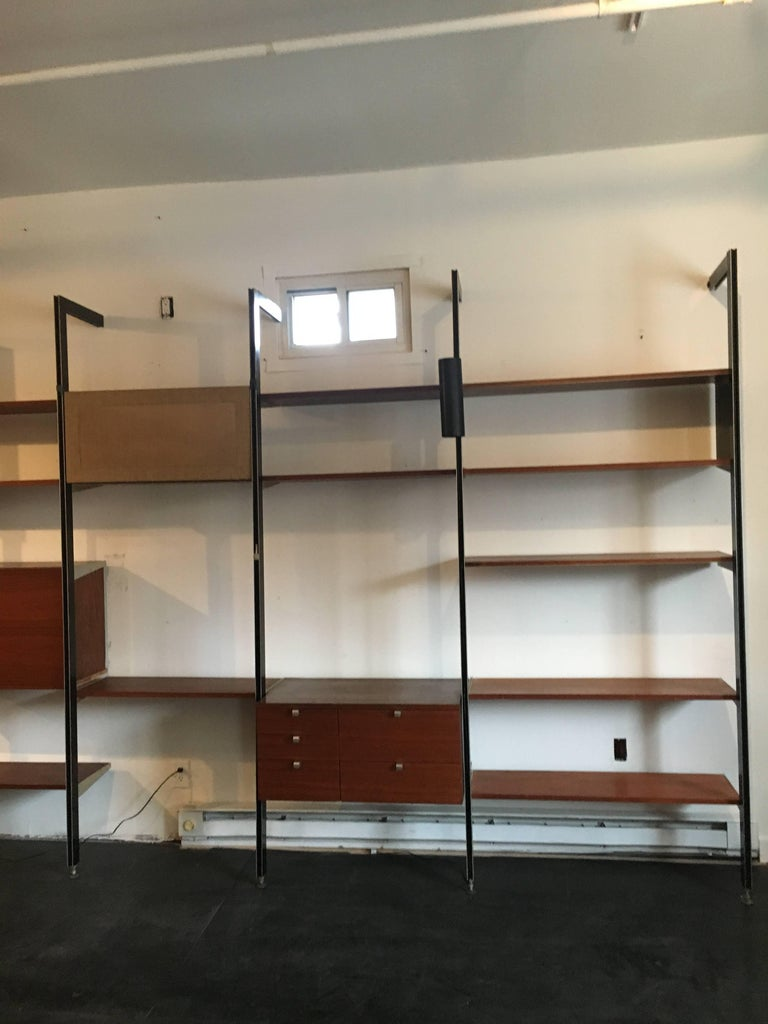 Three bay CSS, designed by George Nelson for Herman Miller, walnut shelves an cabinets.    Our gallery specializes in George Nelson's CSS storage system of 1959. We currently have several bays available with many different cabinet, lighting, and