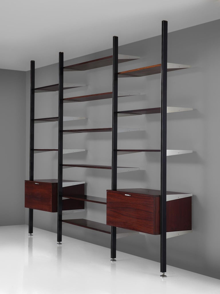 George Nelson for Mobilier International, 'CSS' wall unit, steel, rosewood and aluminum, United States, 1960s  This storage system is designed by Nelson in the 1960s. The wall unit was the first piece of furniture by Miller that made of use of