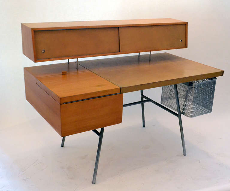 From George Nelson's ground breaking 1948 group of designs for Herman Miller that put the company firmly in the ranks of post war modernism. Nelson's desk was decidedly futuristic, with the floating cabinet above the desktop, containing numerous