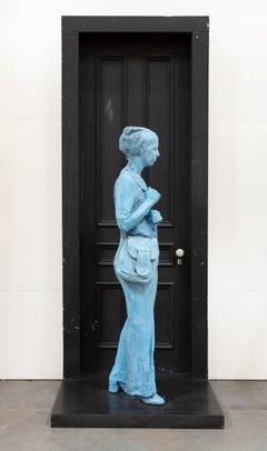Blue Girl in Front of Black Door