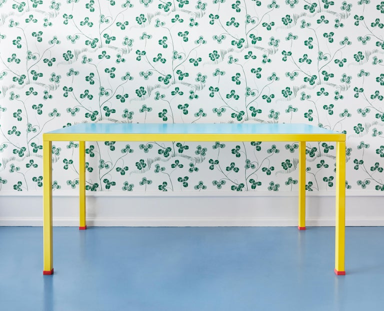 Postmodern-styled 'Violetta' table designed by George Sowden, who was part of the famous 1980s Milanese design collective referred to as the Memphis Group.  Materials consist of painted metal structure, plastic laminate top and feet in rubber.