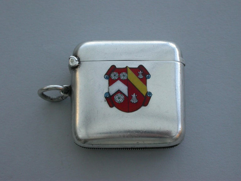 A good quality early 20th century silver and enamel Vesta case of rounded rectangular form with sprung hinged lid and attached suspension ring, the face enameled with the coat of arms of Wadham College, Oxford. The reverse engraved with initials and