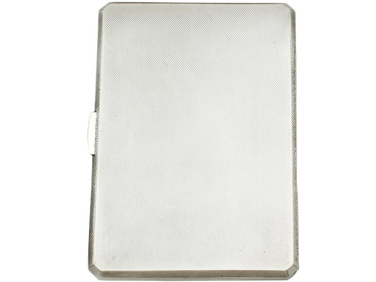 An exceptional, fine and impressive vintage George VI English sterling silver and enamel cigarette case; an addition to our collectable silverware collection.  This exceptional vintage sterling silver cigarette case has a plain rectangular form