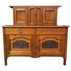 George Walton Style of a Small Arts & Crafts Oak Sideboard with Floral Carvings