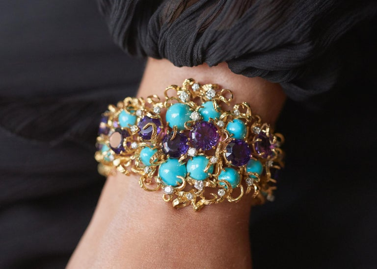 A faceted amethyst, cabochon turquoise, diamond, 18 karat gold, and platinum bracelet, by George Weil, c. 1960.   The bracelet is stamped G. Weil, Plat, 18CT. It is 7