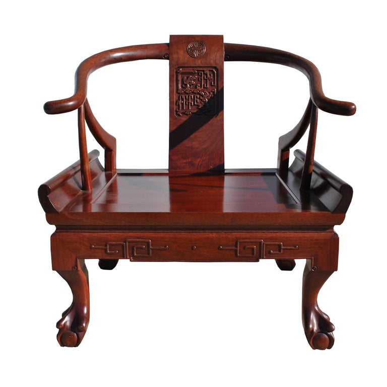 George Zee and Co Hong Kong.     Chinese Ming style horseshoe chair in rosewood by George Zee and CO.   A contemporary rendition of the traditional Ming chair in rosewood. Clawfoot and ball with horseshoe arching back. Embellished with