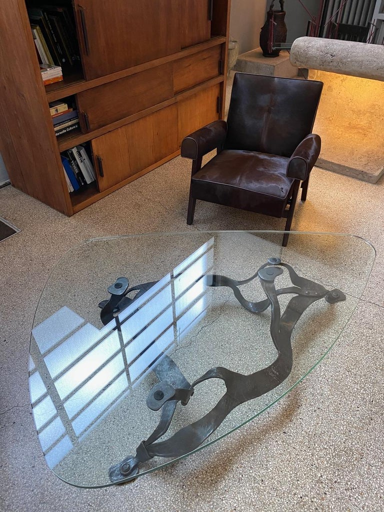 Georges Charpentier Alias Gino (born in 1937)  France, circa 1970 Wrought iron coffee table Size basement: H. 34.5 cm x L. 150 cm x D. 92 cm Size glass top L. 165 cm x D 130 cm x 2 cm.
