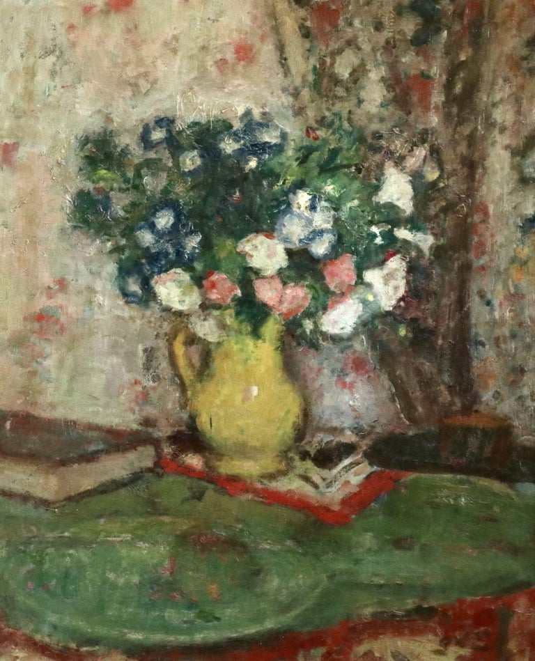 Wonderful still life painting by Georges D'Espagnat of flowers in a yellow jug on a table beside a book. Oil on canvas circa 1930. Signed lower right. Framed dimensions are 32 inches high by 28 inches wide.  From the beginning of his career it was a