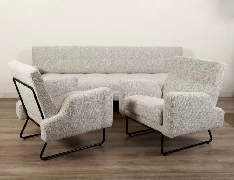 Rare living room set designed by Georges Frydman for EFA, French editor, in 1950s This living room set consist of 2 armchairs and 1 sofa. They feature a distinctive design from fifties with a black lacquered tubular steel frame and aileron shaped