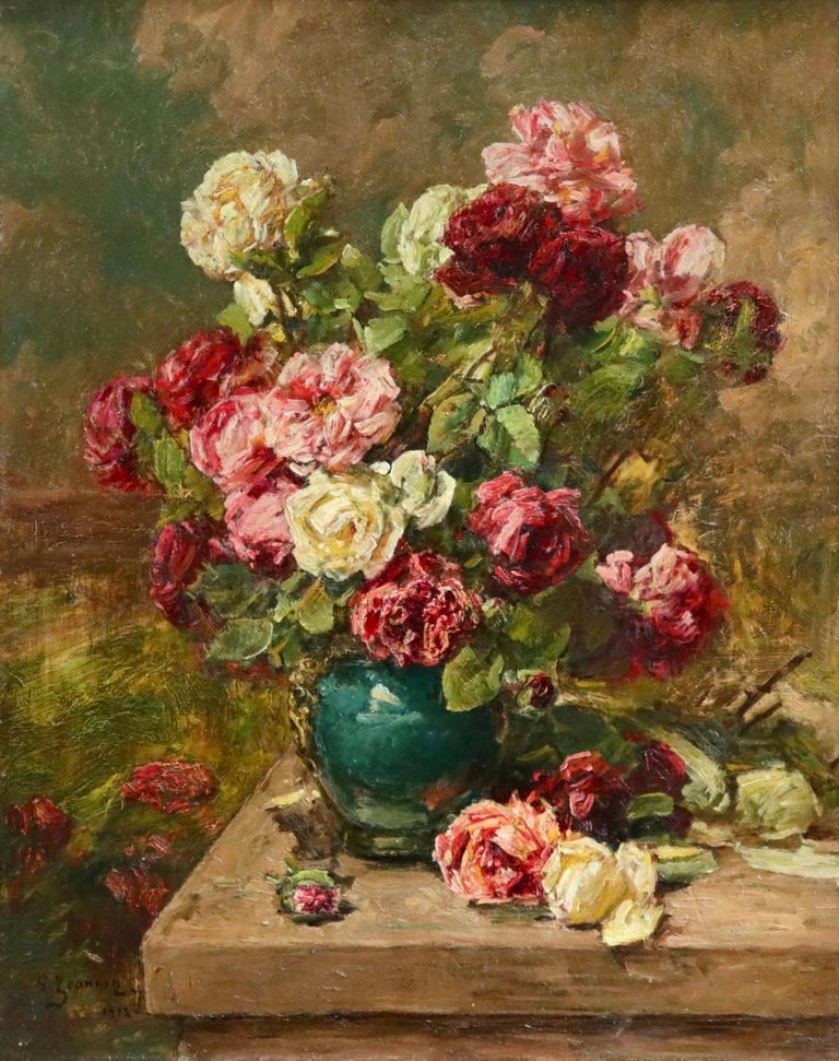 Oil on canvas by Georges Jeannin depicting a green ceramic vase filled with red, pink and cream flowers on a table in an interior. Signed and dated lower left. Framed dimensions are 40 inches high by 34 inches wide.  Georges Jeannin painted bouquets