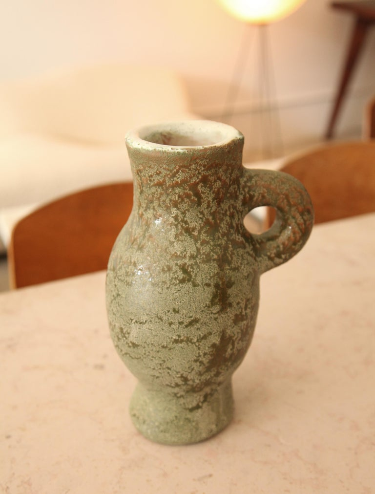 A nice example of a pitcher by Georges Jouve, circa 1955. Marked with cypher on bottom.