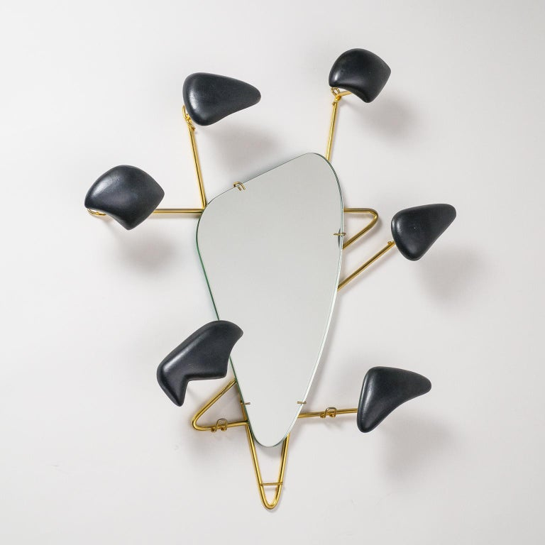 Stunning sculptural mirror by Georges Jouvé for Marcel Asselbur. Rare six arm version, each with an abstract Jouvé ceramic form which can support a hat or coat.