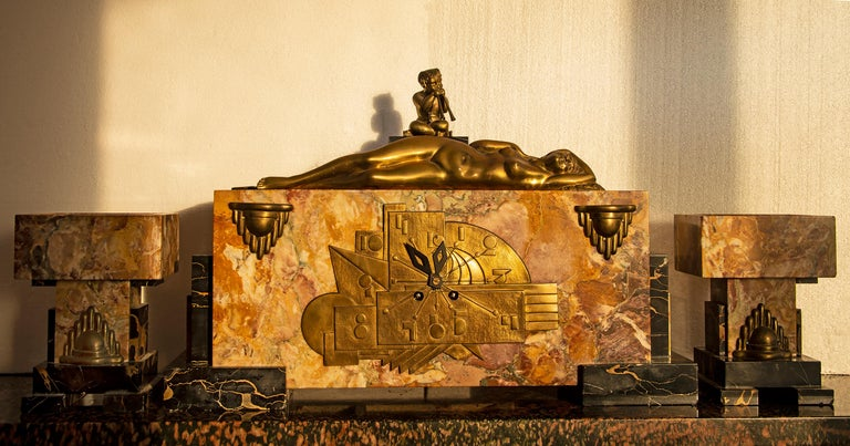 Georges Lavroff (Georgi Dmitrievich Lavrov, Russian 1895-1991) Art Deco  Marble Clock with Bronze Sculpture of  voluptuous Reclining Nude and fawn playing the pipes of Pan . with GARNITURES   It's a beautiful museum piece Extra fine and rare  with