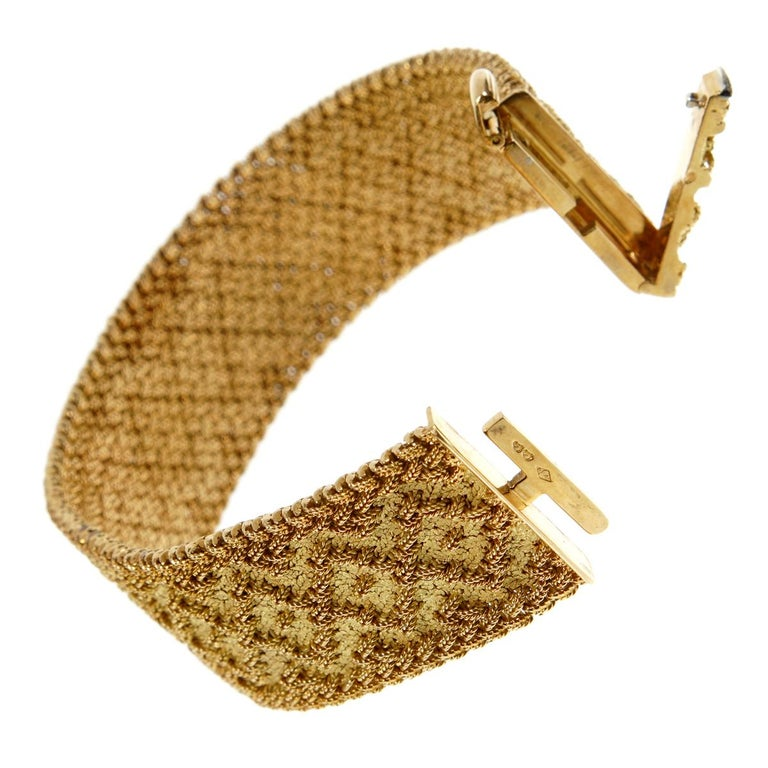 An iconic design bracelet by  Georges L'Enfant showcasing a textured bracelet to resemble embroidery showcasing overlapping diamond shaped motifs. Georges L'Enfant made this pattern for both Cartier Paris and Van Cleef & Arpels. The bracelet is