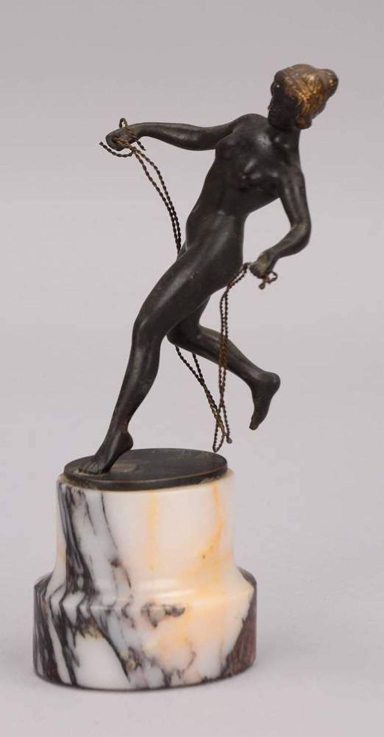 This bronze shows a nude woman, jump roping on a marble foot.  Georges Morin (* 30. April 1874 in Berlin; † 5. Februar 1950) was a german Painter, Sculptor and Medailleur.