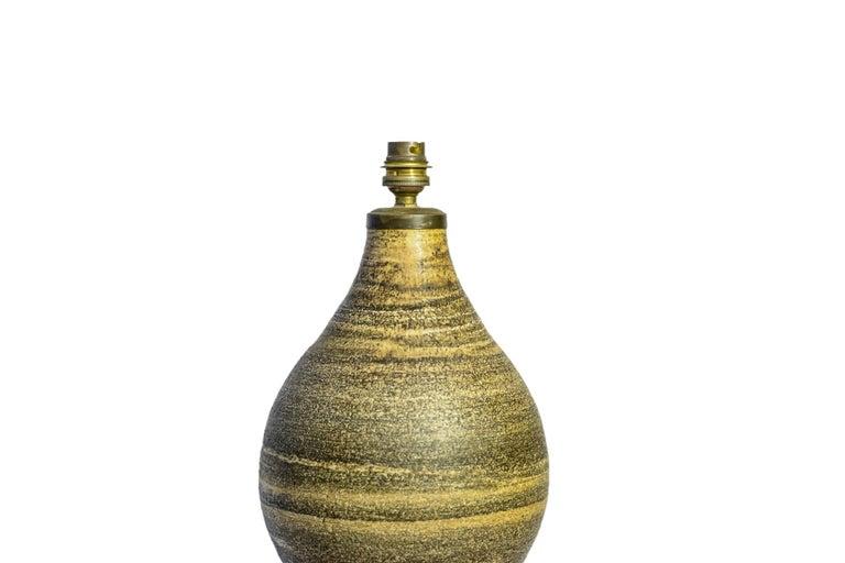 Georges Pelletier, Table lamp, Ceramic, Signed, France, circa 1970.   Measures: Height 58 cm, diameter 25 cm.