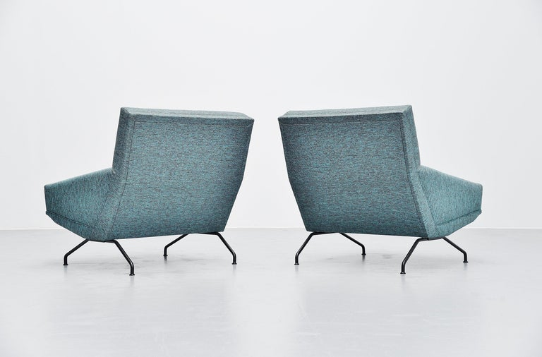 Fabulous pair of lounge chairs designed by Georges van Rijck and manufactured by Beaufort, Belgium 1960. The chairs have solid steel legs, black painted. And are newly upholstered at some point with fabric that fits the period perfectly. A nice sea