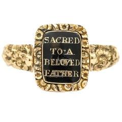 Georgian 14 Karat Gold, Black Enamel and Seed Pearl Swivel Mourning Ring, c.1817