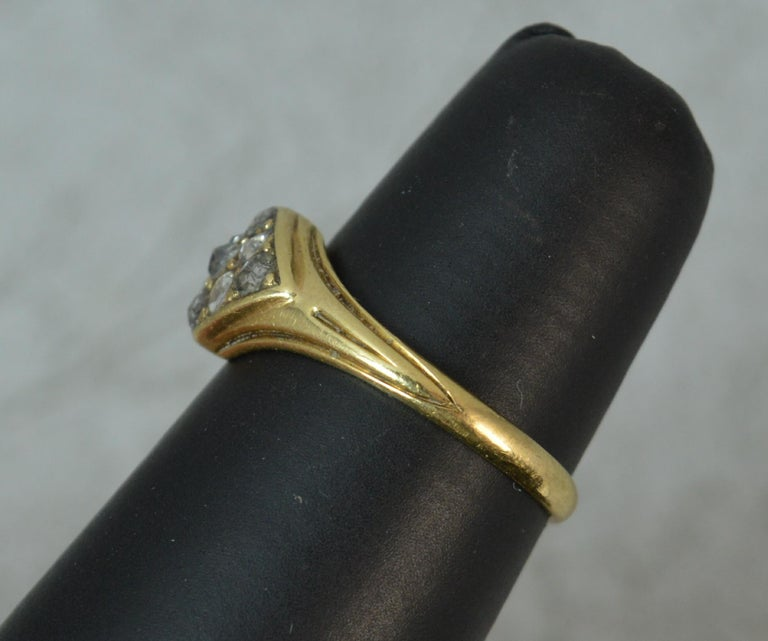 A superb Georgian era cluster ring. 18 carat yellow gold example. Designed as a four sided cluster head set with nine natural rose cut diamonds of various shapes, in closed back setting. 10mm x 7.5mm cluster head.  CONDITION ; Good for age. Clean,