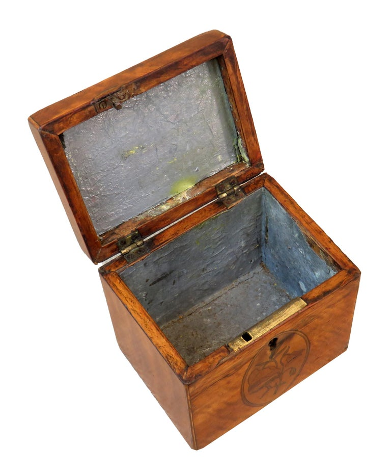 An attractive George III period satinwood oblong tea caddy having original inlaid decoration and original foil lined interior.  (Tea was a precious commodity in the 18th century and  tea caddies were used to both preserve the tea leaves, but