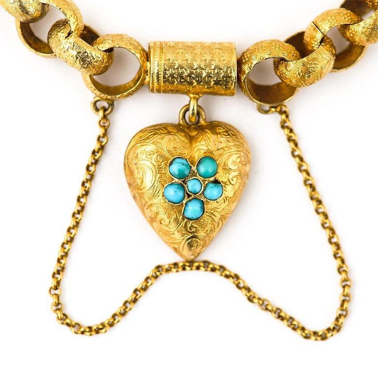 An exceptional Georgian 20 karat gold round belcher link bracelet. Each link is chased with either star or forget me knot motifs. The scroll engraved padlock is set with five turquoise stones, set as a forget me knot, so significant as the plaited