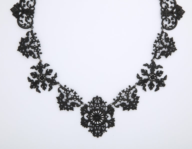 Think of lace made from iron when you view this Berlin Iron necklace with links of leaves, flowers and frills. It is rare to be able to purchase this jewelry. It can be found mostly in museum collections, at times, only in fragments.  Made in the