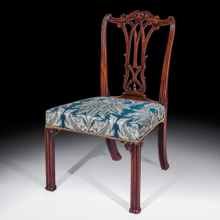 Fine George III period mahogany side chair of outstanding quality, in the style of Thomas Chippendale's 'Director'. Two chairs available. English, circa 1765.   With a shaped foliate carved crest rail over a pierced Gothic splat back and a