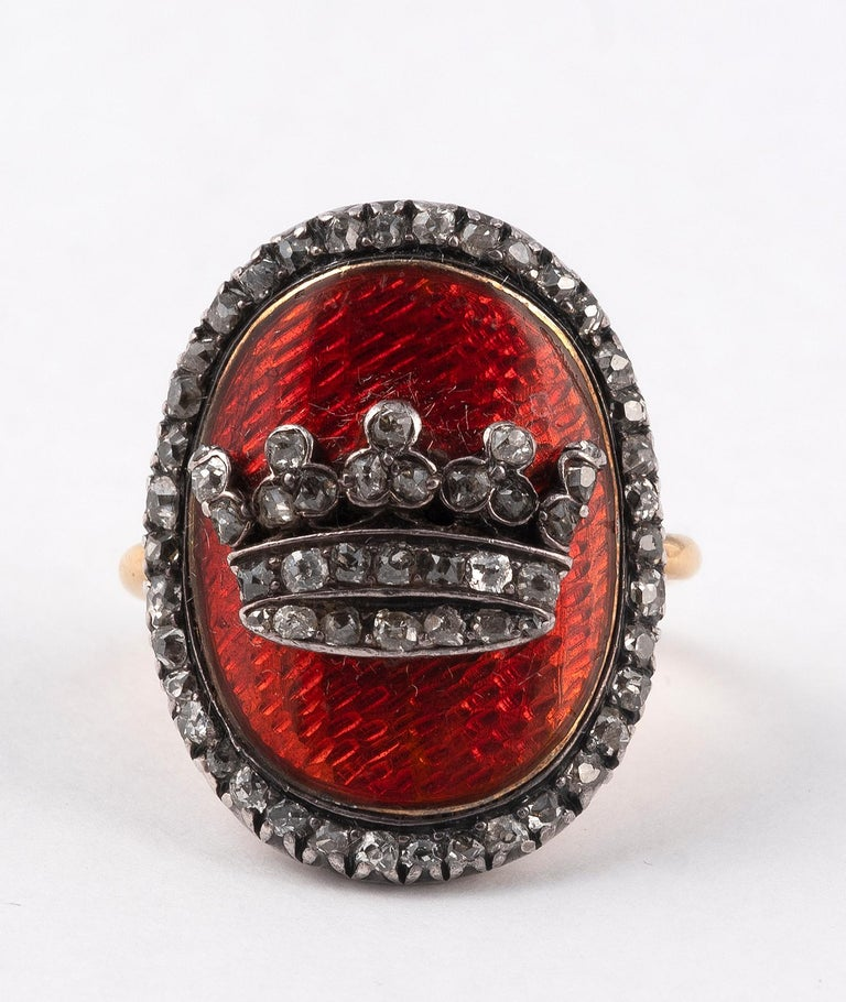 Ring in yellow gold 18 carats and silver decorated with a crown on a red guilloche background and set with diamonds cut in rose. Size of finger: 5  Gross weight: 9,6 g