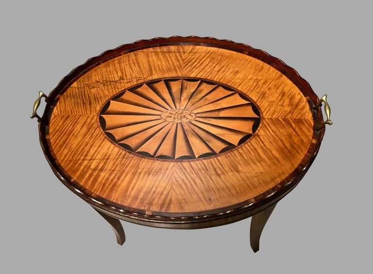A fine quality Georgian inlaid satinwood tray with a beautifully rendered central inlaid fan medallion framed by a satinwood surround, with a scalloped edge, now supported on a custom stand of a later date. Tray, circa 1790.