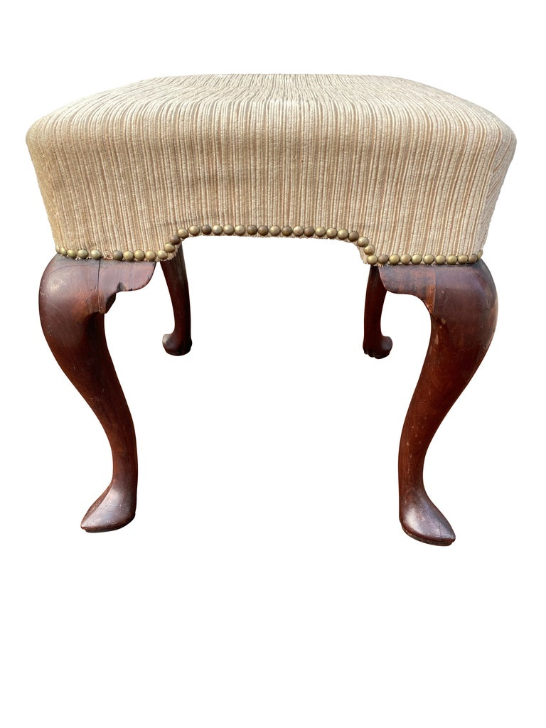 Square beige mohair seat raised on cabriole legs with pointed pad feet.