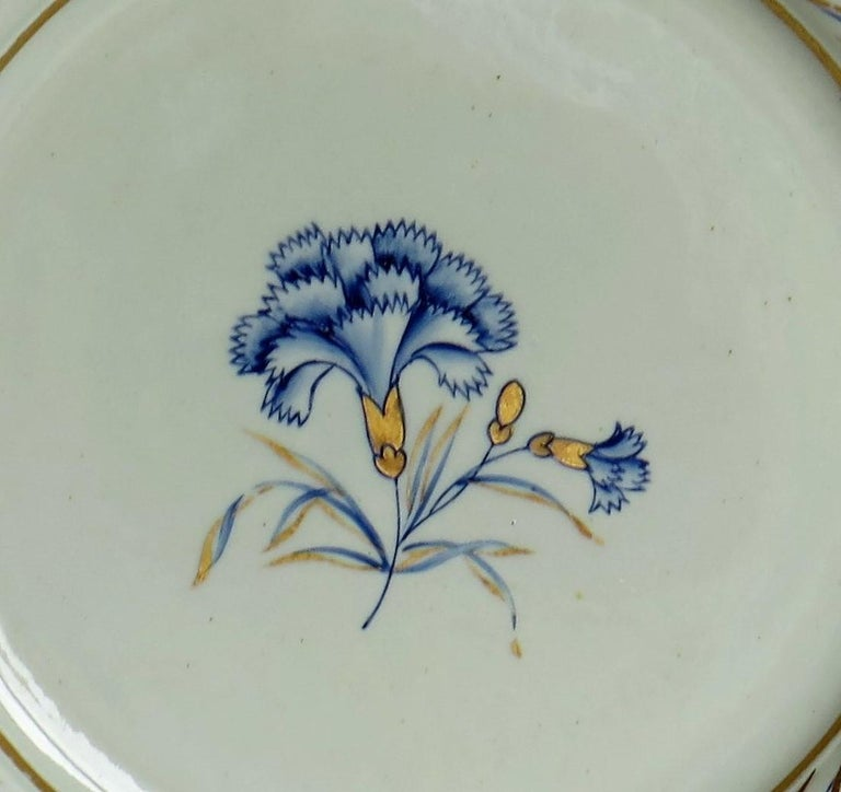 This distinctive ironstone pottery dinner plate was made by the Mason's factory at Lane Delph, Staffordshire, England and is hand decorated in the