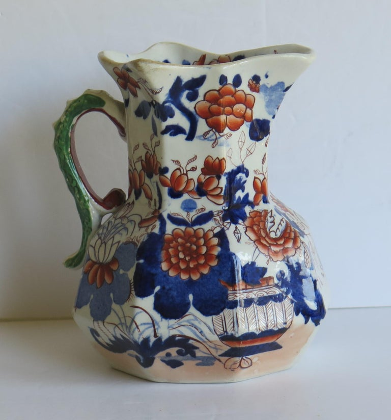 This is a good, early Mason's Ironstone Hydra jug or pitcher in the Basket Japan pattern, made in the English, late Georgian period, circa 1815-1820.  The jug has the octagonal