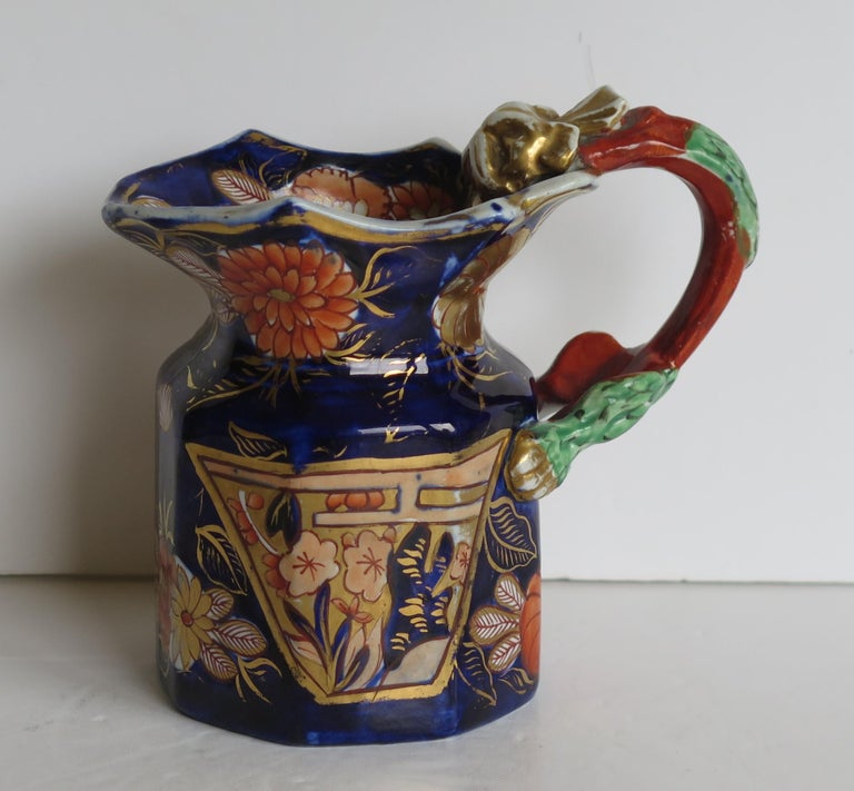This is a fine and rare, ironstone pottery jug or pitcher in the School House pattern, made by Mason's Ironstone, of Lane Delph, Staffordshire, England, in the George 111rd period, circa 1817.  The jug is octagonal in form with the