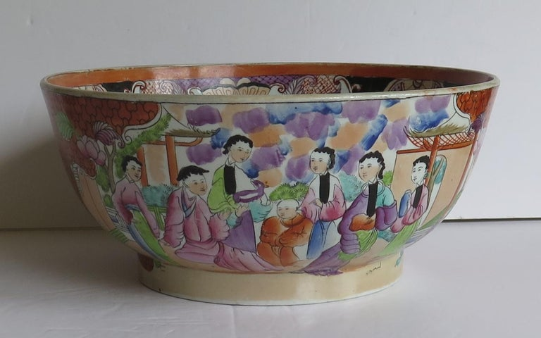 This is a beautiful Mason's Ironstone pottery large bowl in the very decorative Red Scale Sacrificial Lamb, oriental people pattern, produced by the Mason's factory at Lane Delph, Staffordshire, England, circa 1813-1815.  This large bowl is well
