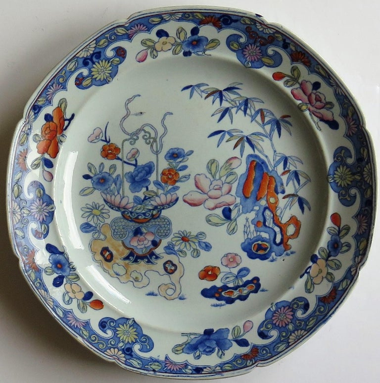 This is a very decorative large dinner plate by Mason's Ironstone, Lane Delph, England in the Bamboo and Basket pattern, dating to the early 19th century, Georgian period, circa 1813-1820.  The plate is large, fairly deep and circular in shape