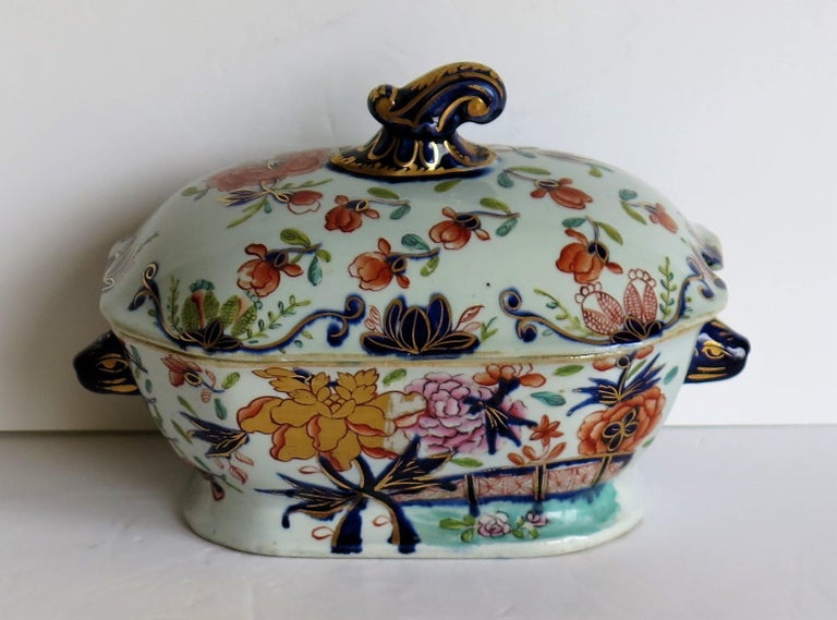 This is a superb Ironstone Sauce Tureen, complete with lid, made by Mason's of Lane Delph, Staffordshire, England, during the early part of the 19th century, circa 1815.  This tureen is well potted with a rectangular curved shape on a low foot.