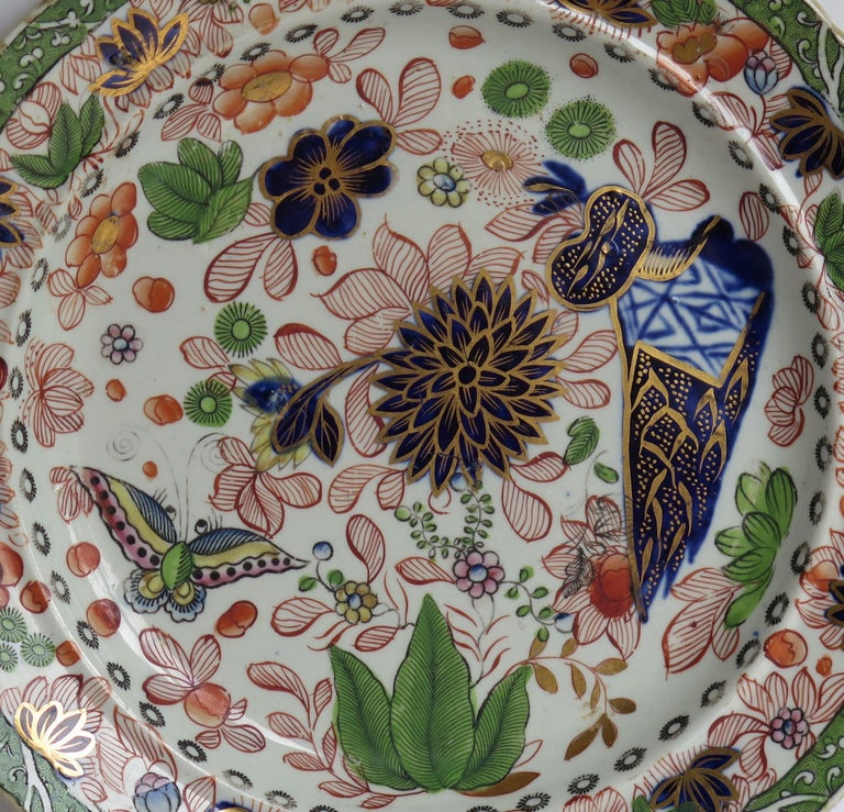 This is a fine ironstone pottery side plate made by the Mason's factory at Lane Delph, Staffordshire, England and beautifully hand decorated in the Butterfly & Mazarine Chrysanthemum Pattern, fully stamped and dating to the earliest period of