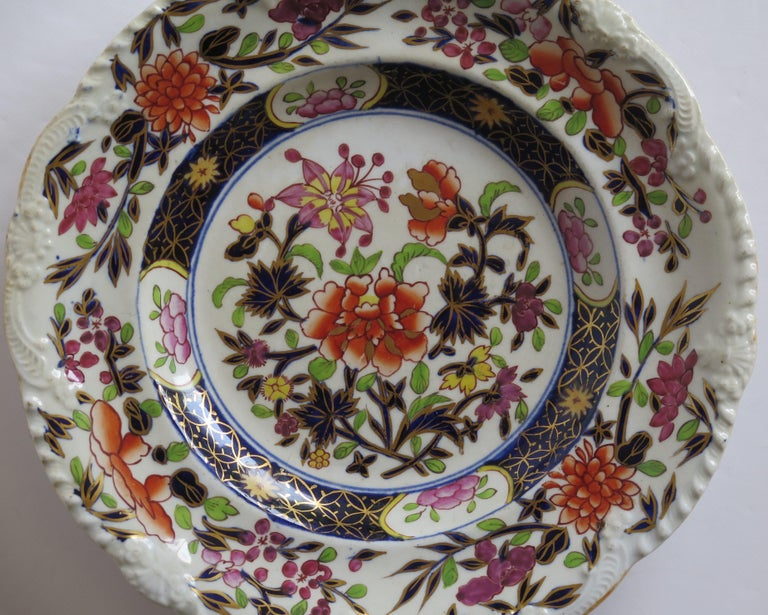 This is a very good Ironstone pottery small side plate, made by the Mason's factory at Lane Delph, Staffordshire, England and are decorated in the Heavily Floral Japan pattern, fully stamped and dating to the earliest period of Mason's Ironstone