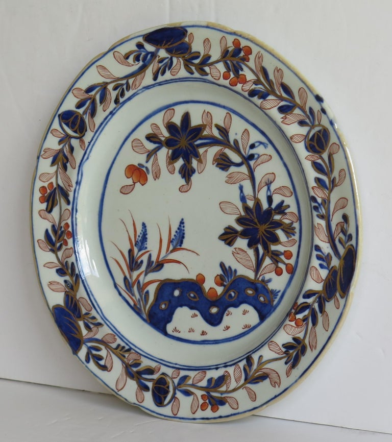 This is a fine Ironstone pottery side plate made by the Mason's factory at Lane Delph, Staffordshire, England and beautifully hand decorated in the Rock, Leaves and flowers Pattern, fully stamped and dating to the earliest period of Mason's