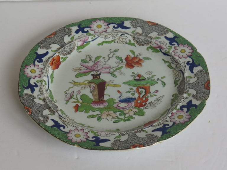 This is a hand-painted Mason's ironstone side plate, in the Table and Flower pot gilded pattern, from their earliest George 3rd period, circa 1818.  This plate is well painted in the Chinoiserie pattern called the Table and Flower Pot pattern,