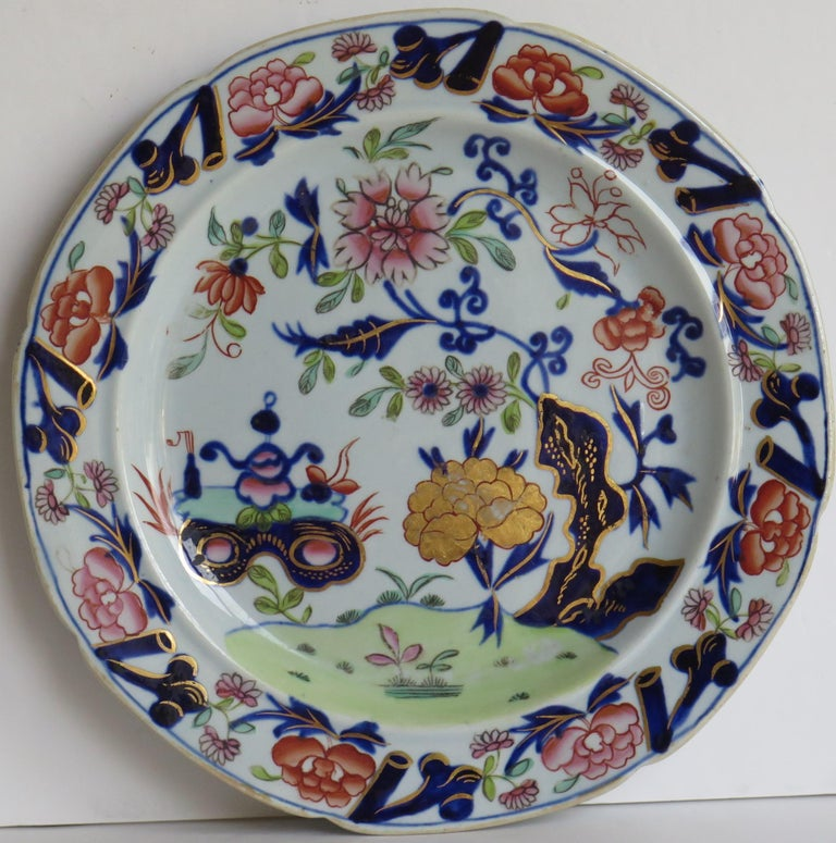 This is a fine Ironstone pottery side plate made by the Mason's factory at Lane Delph, Staffordshire, England and beautifully decorated in the Small Vase, flower & Rock Pattern, fully stamped and dating to the earliest period of Mason's Ironstone