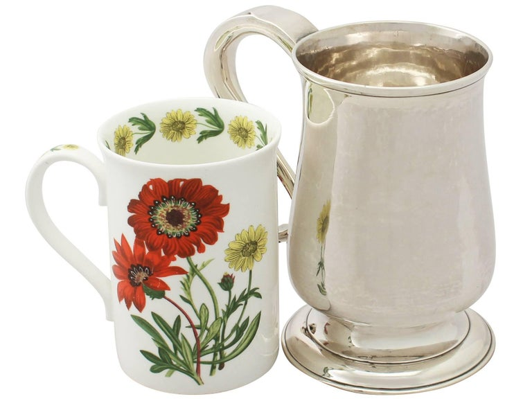 A fine and impressive antique Georgian Newcastle sterling silver pint mug made by John Langlands I and John Robertson I; an addition to our silver wine and drinks related collection.  This fine antique George III sterling silver pint mug has a