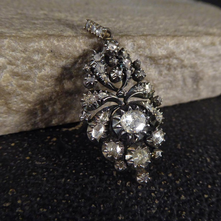 A striking pendant showing such quality aesthetic from the Georgian era. This lovely pendant features approximately 1.50ct of Rose Cut Diamonds in a closed back setting regularly used in Georgian jewellery. In such lovely condition and wearable,