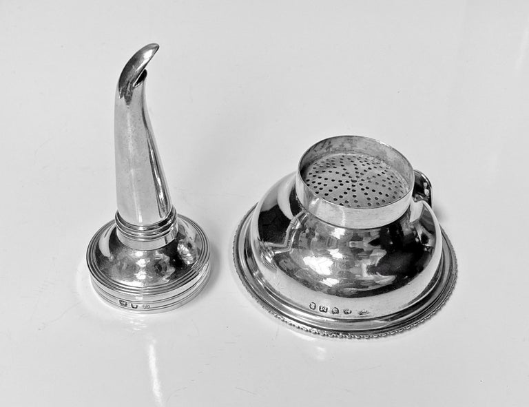 Antique Georgian silver wine funnel, London 1807 Thomas Wallis 11. The funnel of typical form, the base with gadroon surround, plain body and upper reed funnel. Marked on body and strainer. Measures: Height 4.75 inches. Weight 86.28 gm. Condition: