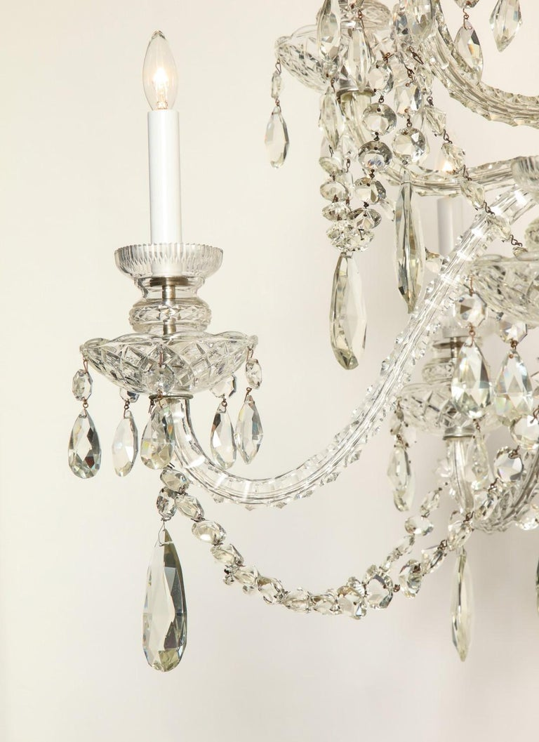 A Georgian style hand-cut and blown lead Waterford Crystal chandelier, crystal ball finial, crystal beaded drapes.