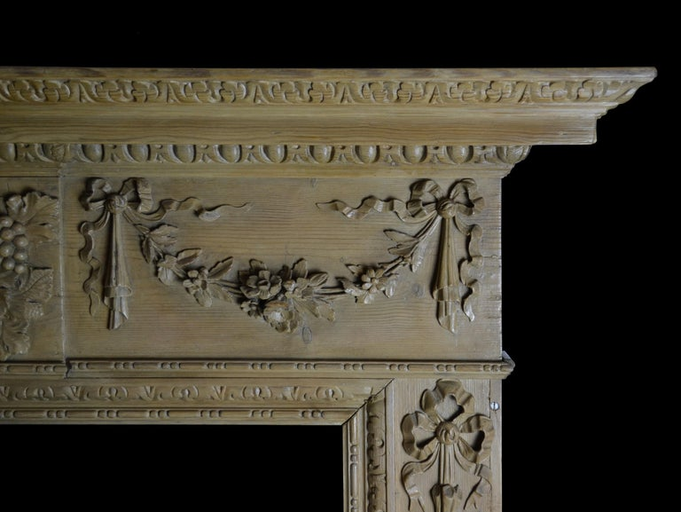 Hand-Carved Georgian Style Pine Mantelpiece with Mask Center Plaque For Sale