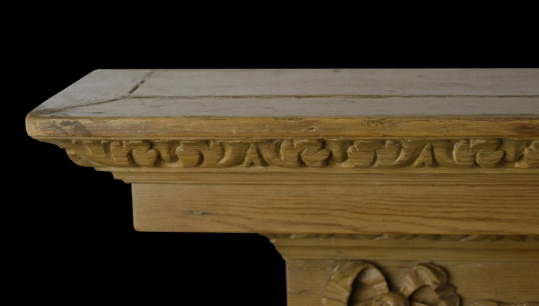 20th Century Georgian Style Pine Mantelpiece with Mask Center Plaque For Sale